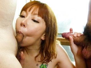 Minami Kitagawa soaps up her sexy body before jerking cocks